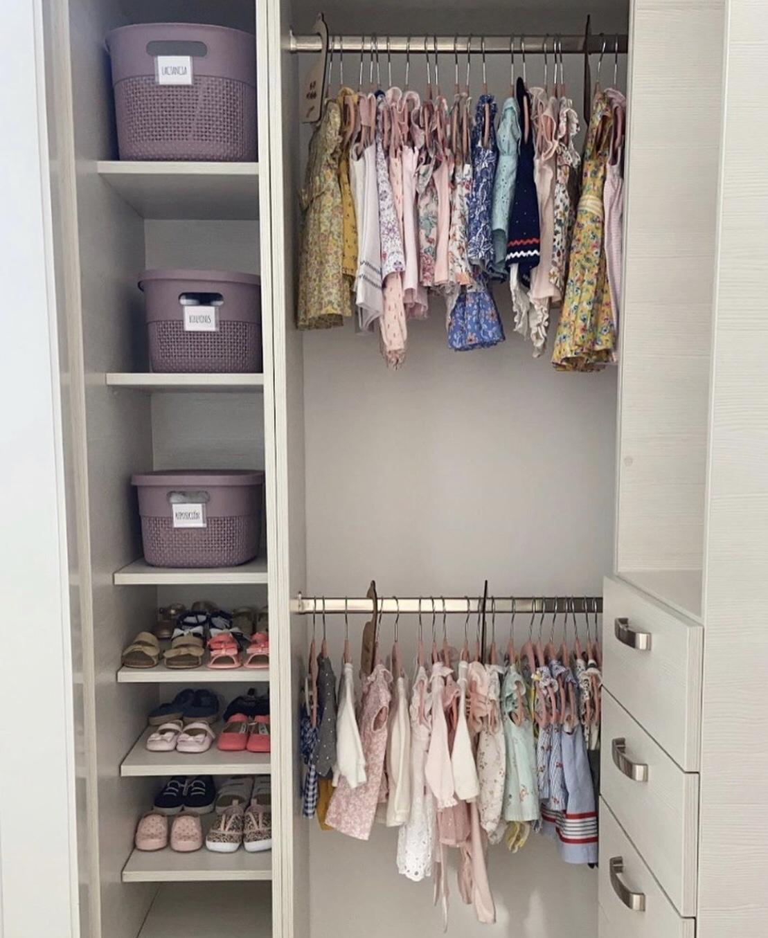 baby wardrobe organisation. wardrobe with second rail