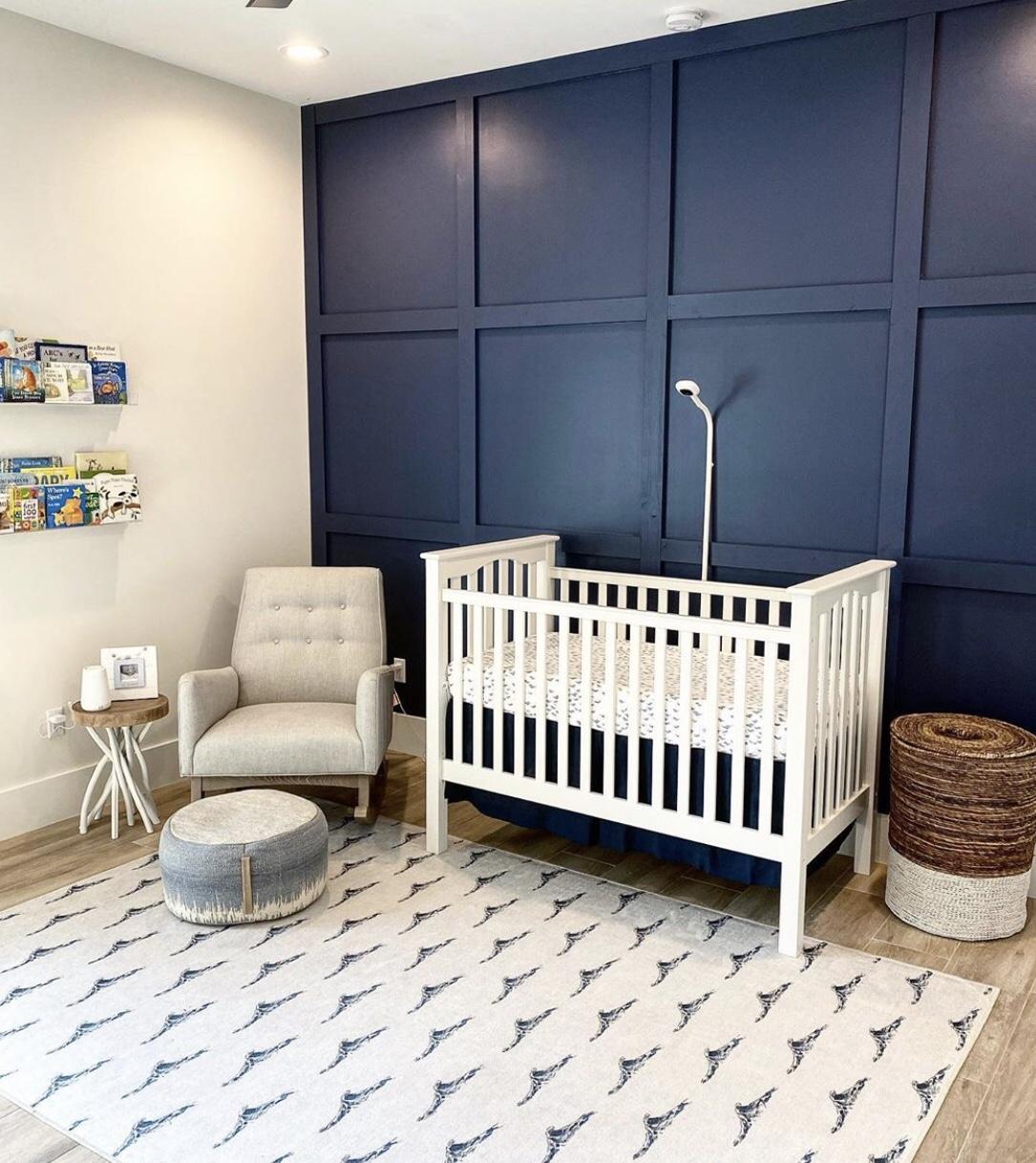 Baby boy nursery-blue textured wall, wall mounted bookshelf