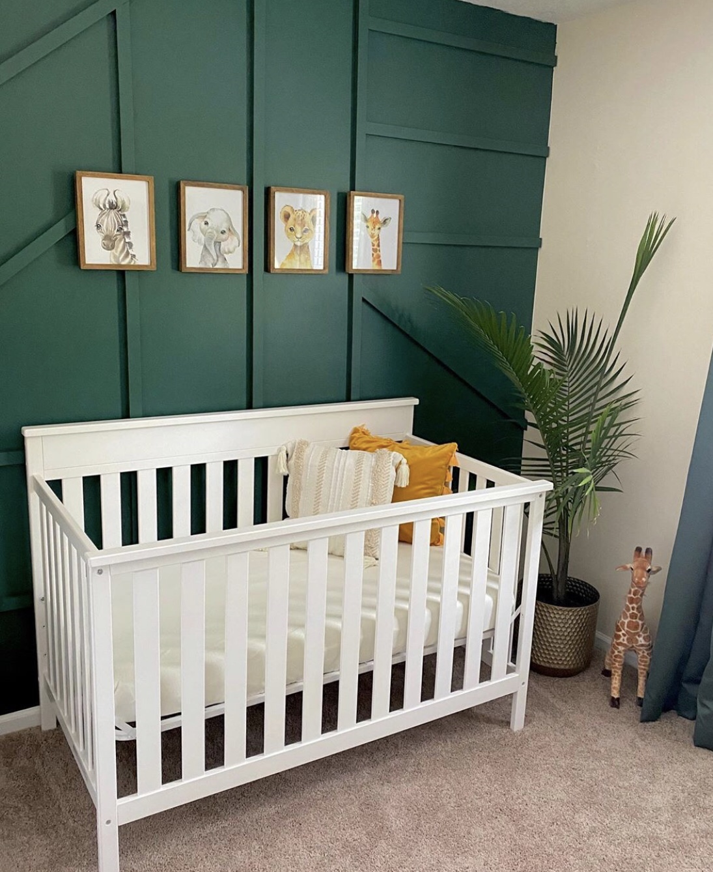 Baby boy nursery with green wall jungle theme