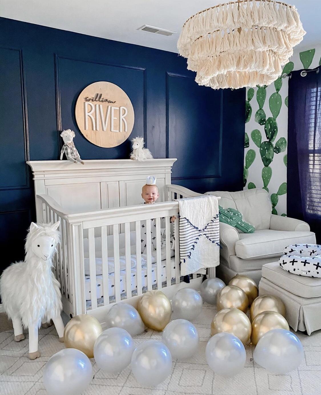 boy nursery dark blue wall white crib white cot llama