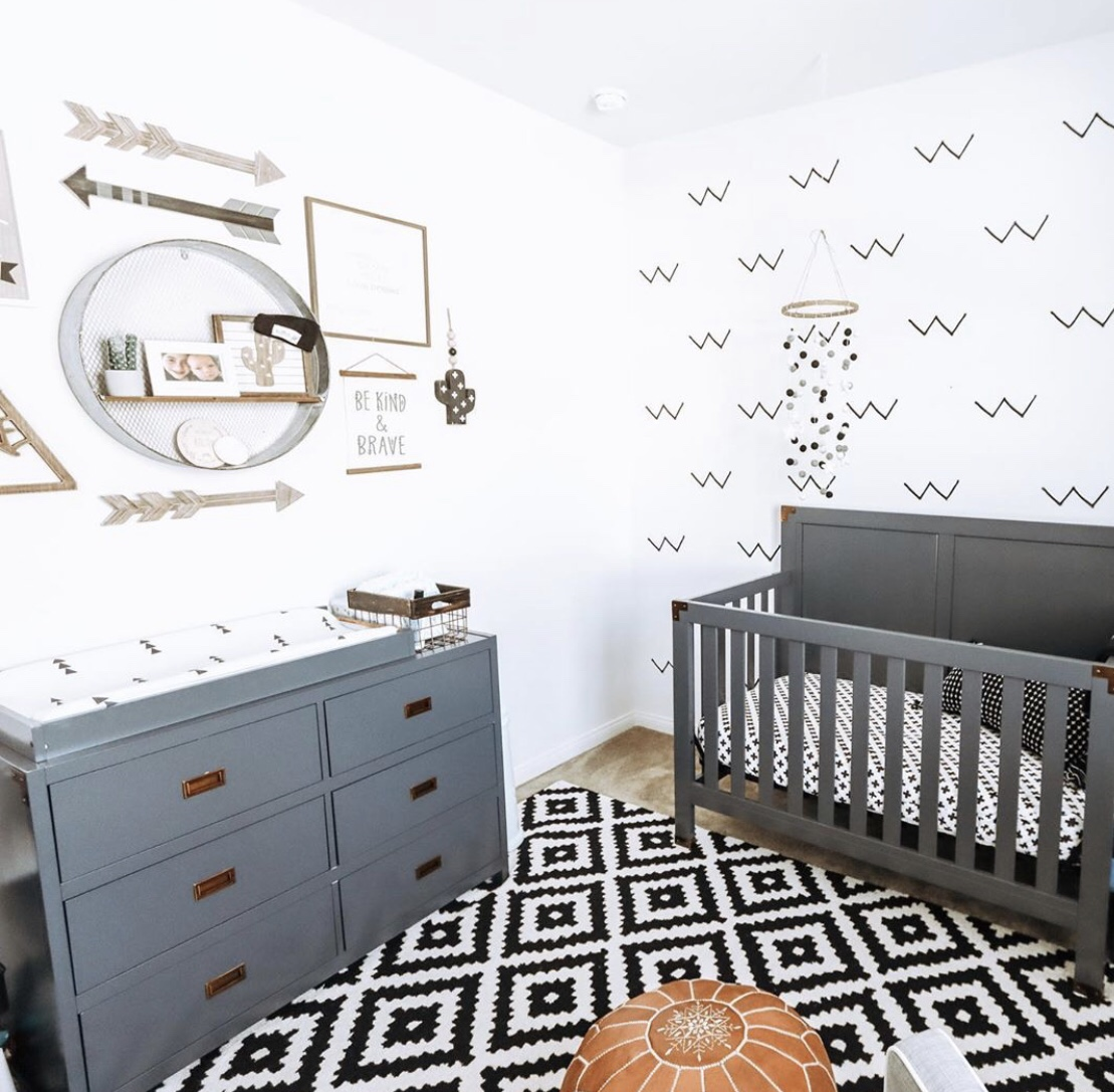 baby boy grey nursery with wall decals and white walls