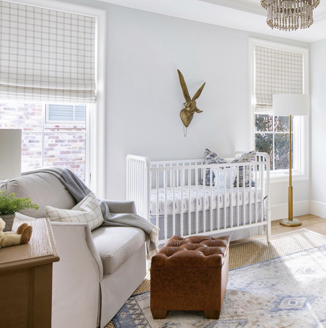 boy nursery light blue walls and bunny head with floor lamp